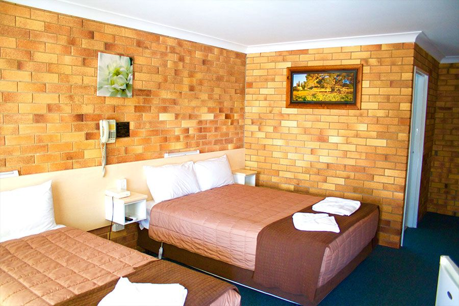 Queen & Single Beds Room